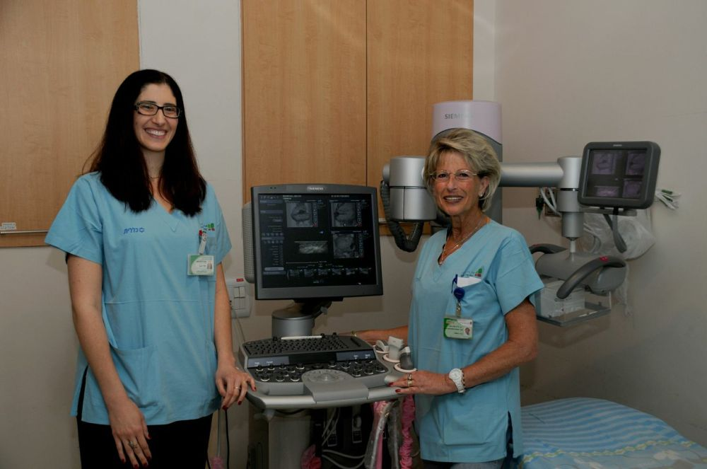 Rabin Medical Center nurses posing next to cutting edge breast cancer detection technology.