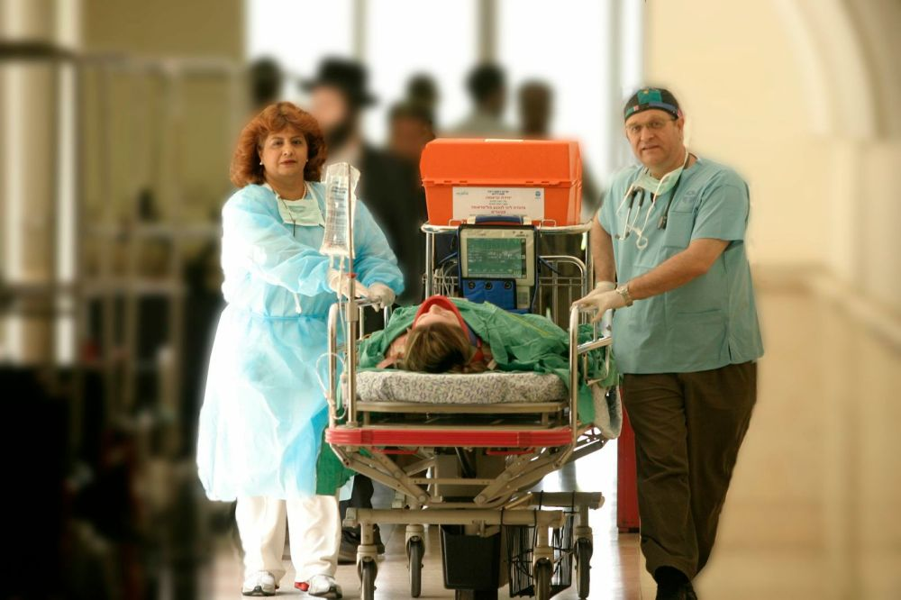 Rabin Medical Center doctors on the way to a lifesaving procedure.
