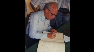 Yitzakh Rabin signing the guest book at Beilinson Hospital, soon to be renamed the Rabin Medical Center